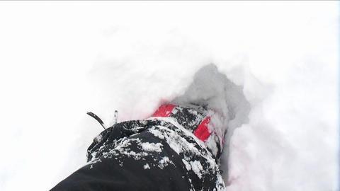 POV of climber walking through deep snow Footage