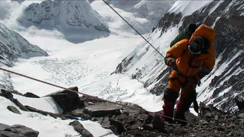 Climber ascending rocky patch on ropes Stock Video Footage