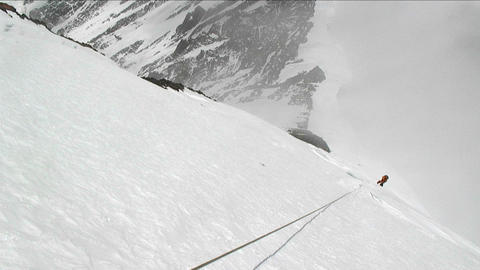 Looking down rope as climber ascends Stock Video Footage