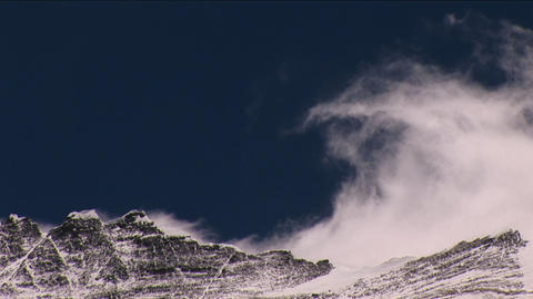 Wind rolling off Everest summit, big snow plume Stock Video Footage