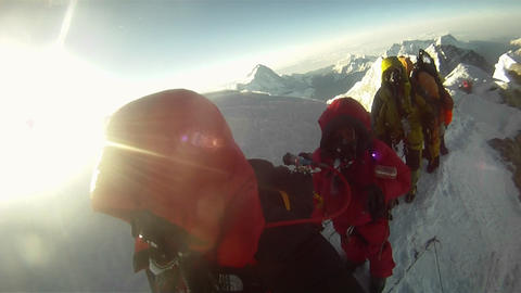 Line of climbers approaching Hilary Step Stock Video Footage