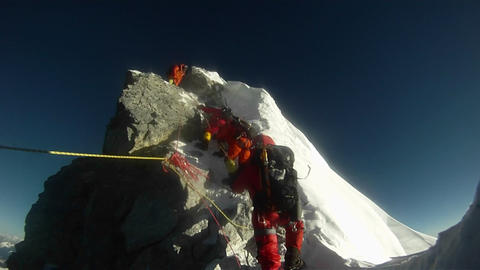 Climber takes first steps up Hilary Step Stock Video Footage