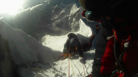 Looking down at line of climbs waiting Footage