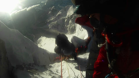 Looking down at line of climbs waiting Stock Video Footage