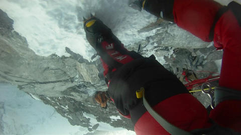 Crampons shot, biting into the snow and rock Stock Video Footage