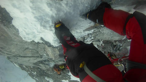 Crampons shot, biting into the snow and rock Footage