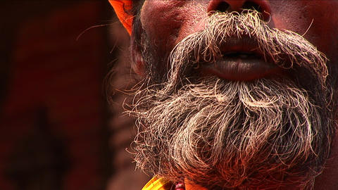 Pan up of Sadhu on streets of Kathmandu Footage