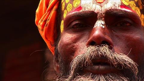 Pan up of Sadhu on streets of Kathmandu Stock Video Footage