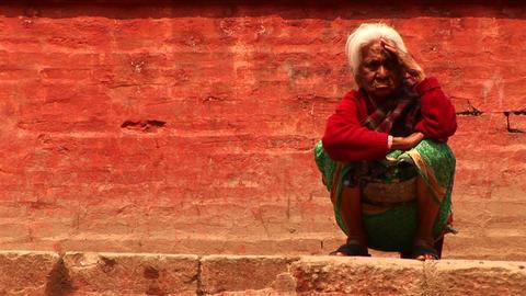 Elderly woman on the sidewalk Stock Video Footage