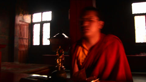 Quick movements, monks chanting Stock Video Footage