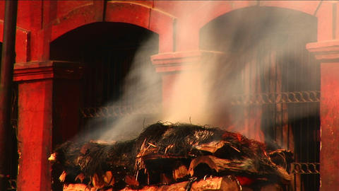 Ceremonial fire out of temple in nepal Footage