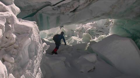 Climber runs under large serac Stock Video Footage
