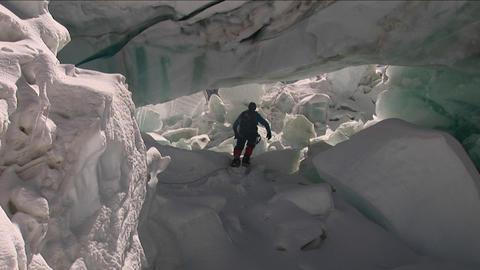 Climber runs under large serac Footage