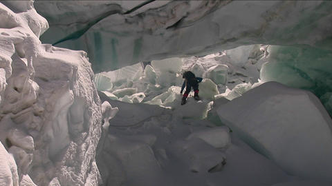 Climber runs under large serac Stock Video Footage