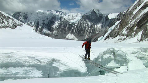 Climber crosses large crevasse above camp one Footage