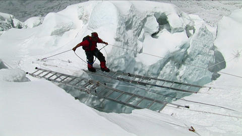 Climber crossing large ladders Stock Video Footage