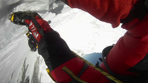Shot through legs down the Lhotse face Stock Video Footage