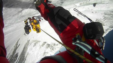 Shot through legs down the Lhotse face Stock Video Footage