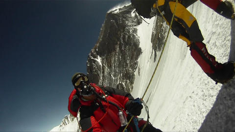 Sweeping shot of line up of climbers Stock Video Footage