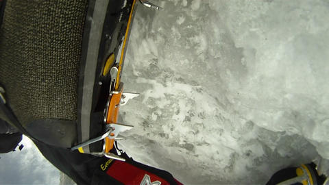 Close-up of climbers crampons in ice Footage