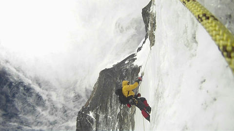 Climber ascends into strong winds Footage