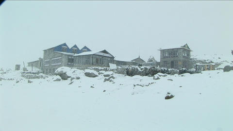 Snow falling on trailside stop in Himalayas. Footage