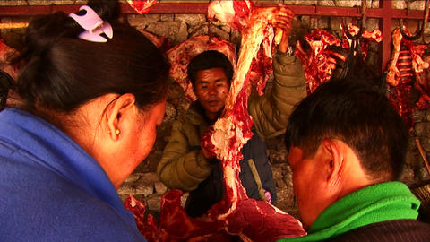 Women at butcher's shop in market Stock Video Footage