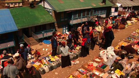 Pan down to namche bazaar market in Nepal. Footage