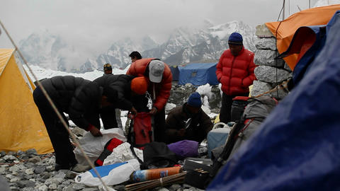 Sherpas packing for high camps on Mt. Everest. Footage