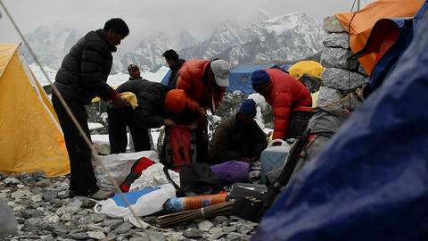 Sherpas packing for high camps on Mt. Everest. Stock Video Footage