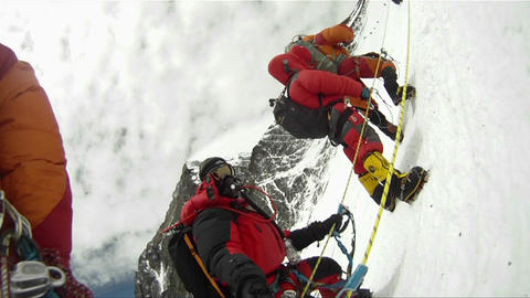 Big line of climbers on Mt. Everest waiting and resting Footage