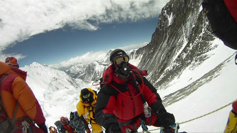 Big line of climbers on Mt. Everest waiting and resting Stock Video Footage