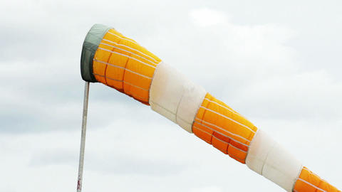 Windsock shows wind direction in airport Stock Video Footage