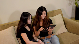 High Angle View of Two Female Friends Playing with Footage