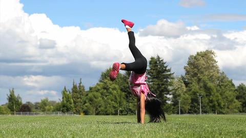 Cute Asian Girl Doing Cartwheels Footage