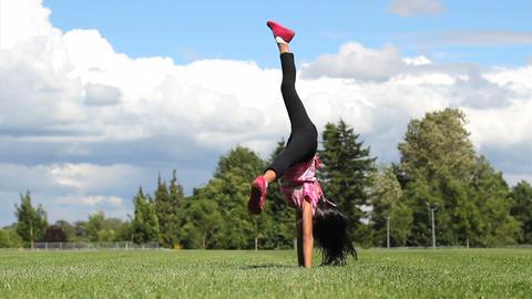 Cute Asian Girl Doing Cartwheels Stock Video Footage