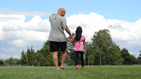 Father & Daughter Walking In Field On Summer Day stock footage