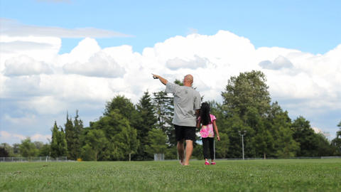 Father & Daughter Walking In Field On Summer Day Stock Video Footage