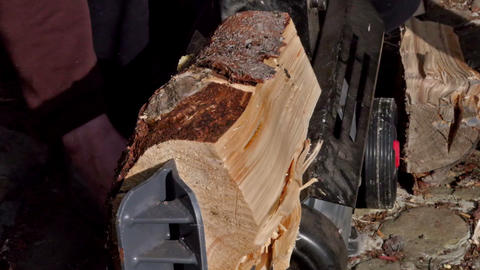 Crashing half o a log of wood in the machine Stock Video Footage