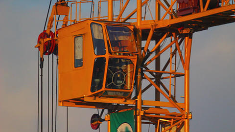 Close-up of working tower crane at sunset Stock Video Footage