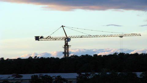 Tower crane at sunset timelapse Stock Video Footage