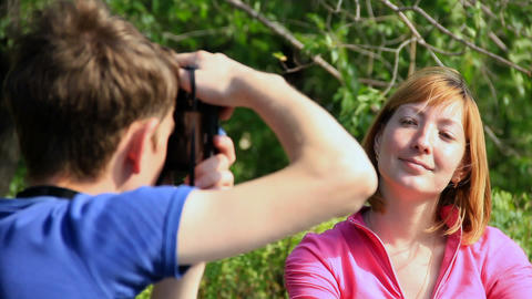 Couple photographed on a tree background Stock Video Footage