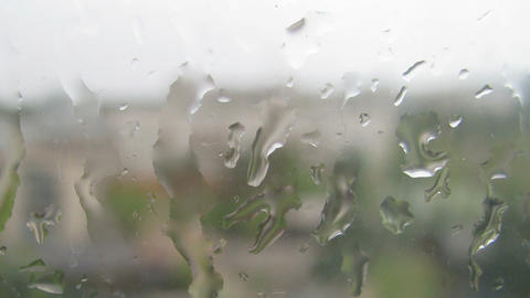 Timelapse of water drops on window glass during th Stock Video Footage