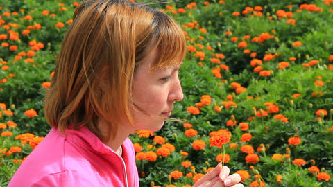 Young girl with marigold flower Stock Video Footage