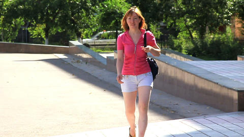 Young girl is walking. Slow motion Stock Video Footage