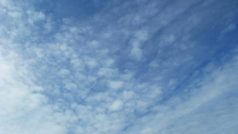 Time lapse of blue sky with fast moving clouds. Lo Stock Video Footage