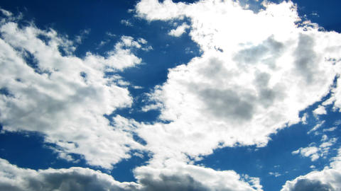 Time lapse of blue sky with fast moving clouds wit Stock Video Footage