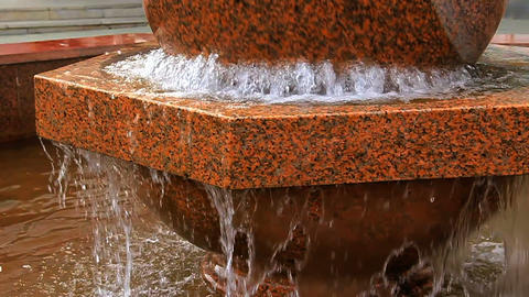 Fountain. Rotating stone sphere in bowl Stock Video Footage