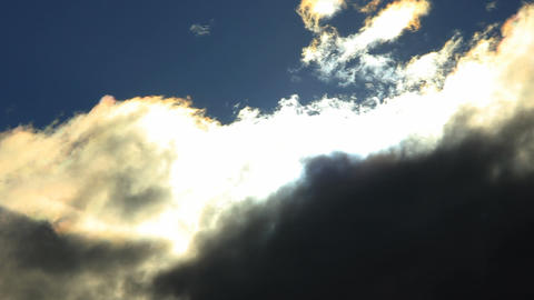 Timelapse of the sun shining through dark clouds Stock Video Footage