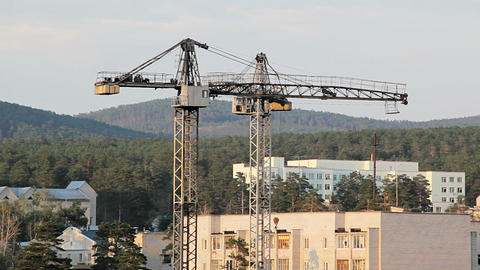 Construction site with two working tower cranes Stock Video Footage